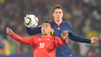 Chile's defender Gonzalo Jara (L) vies with Spain's striker Fernando Torres during their Group H first round 2010 World Cup football match on June 25, 2010 at Loftus Verfeld stadium in Tshwane/Pretoria. NO PUSH TO MOBILE / MOBILE USE SOLELY WITHIN EDITORIAL ARTICLE        AFP PHOTO / FRANCOIS-XAVIER MARIT