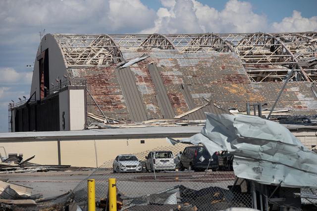 Most of the roof has been torn from an airplane hangar, and debris litters Tyndall Air Force Base, severely damaged after Hurricane Michael, on Wednesday, 17 October 2018. Photo: Scott Olson / Getty Images