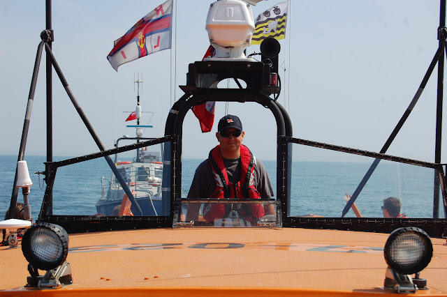 Second Coxswain Dave Riley at the helm, towing a 'casualty' vessel Photo: RNLI Poole/Oli Mallinson