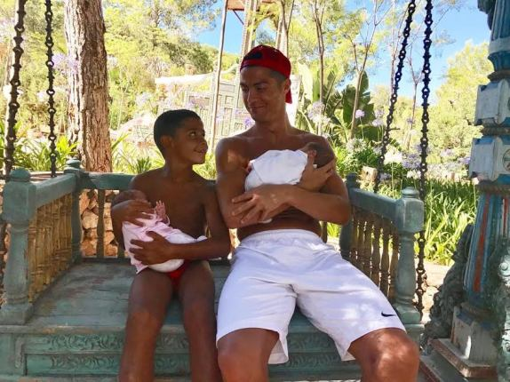 Cristiano Ronaldo & His 5-year-old Son Cuddle His Newborn Twins in New Family Photo