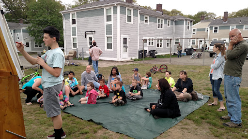 This is great... look behind the kids, on the other side of the driveway... as the kids were paying attention to the lesson, an adult came out and stood at a distance, but heard everything that was going on. When you reach the kids, you reach the adults too!
