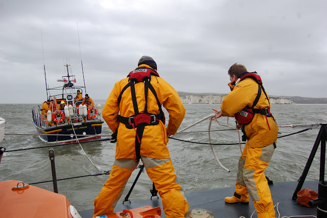 Poole lifeboat Crew Member Joe Manning pulling in the tow rope during a training exercise with Swanage all-weather lifeboat in Poole Bay on Sunday 23 February 2014. Photo: RNLI/Dave Riley