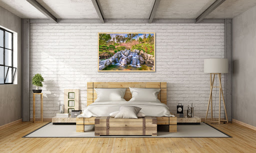 Feng Shui style bedroom with Zen Waterfall painting above bed