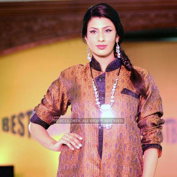 Leena showcases a creation during Year End Expo fashion show, held at hotel Breeze.