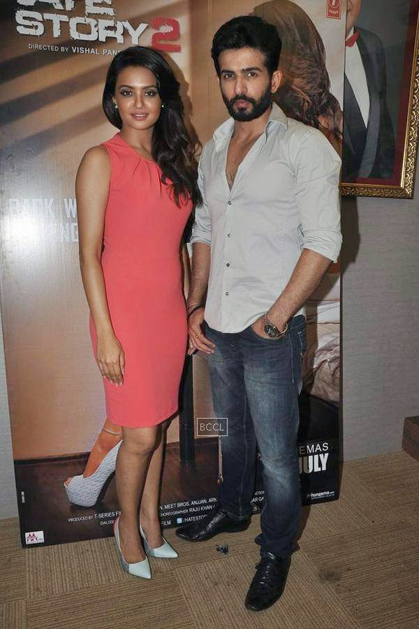 Surveen Chawla and Jay Bhanushali pose for the photogs during the promotion of Bollywood movie Hate Story 2, held in Mumbai, on July 12, 2014. (Pic: Viral Bhayani)