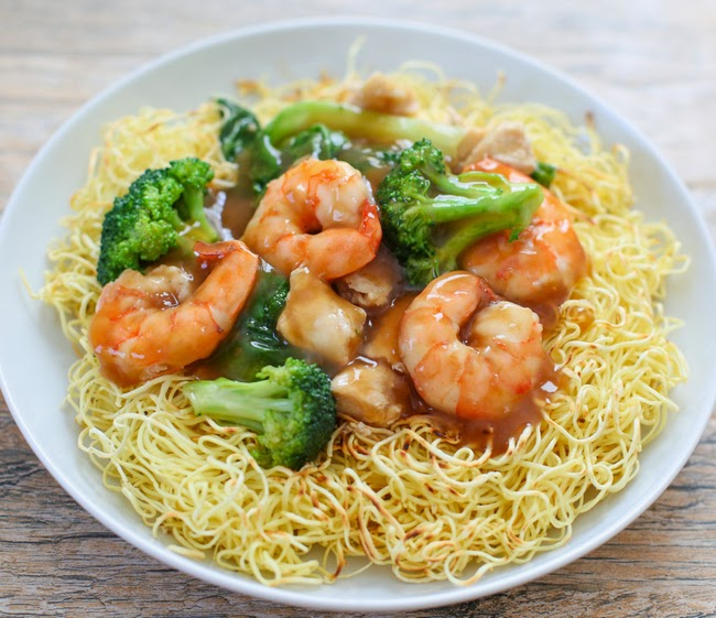 crispy pan-fried noodles topped with shrimp and broccoli