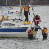 The ILB crew members attach the tow rope to the yacht using a bridle - 21 April 2013.  Photo credit: Dave Riley