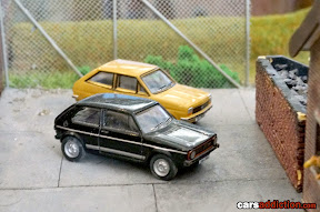 Volkswagen Golf and Ford Fiesa in Train Set