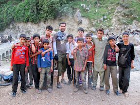 Playing cricket with local kids before Kundal Shahi