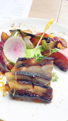 LeChon Crispy Pork Belly with parsley emulsion, plums, and charred spring onions