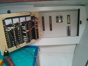 Photo: installing terminal blocks, fuse blocks, and bus bars in electrical panel.