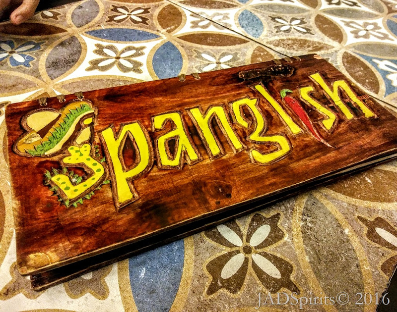 The wooden cover of Spanglish Menu