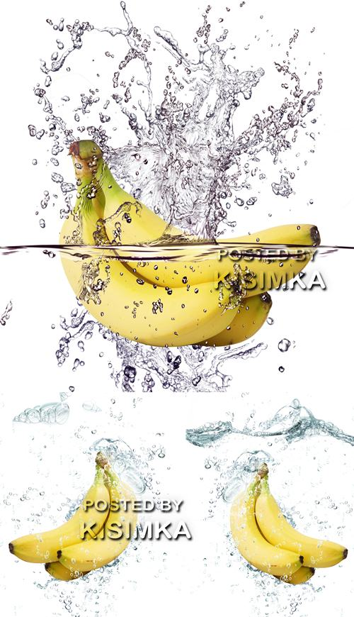 Stock Photo: Bananas in water with splashes and vials