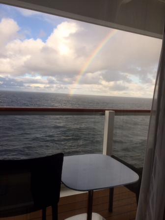 Palmia Observatory Resident Astronomers and rain driven rainbow at sea