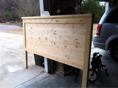 An in progress picture of a wood headboard without stain