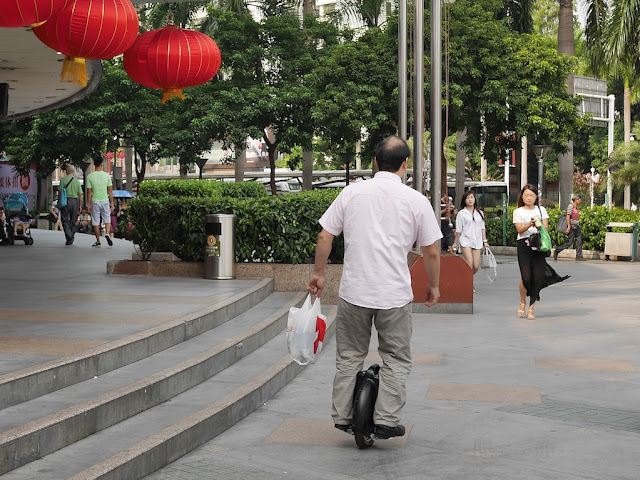 man riding an electric unicycle in Zhuhai, China