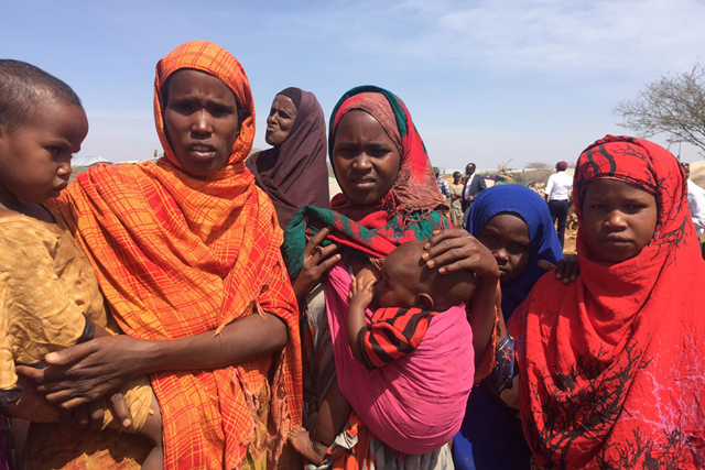Women displaced by drought waiting to meet António Guterres during his visit to Baidoa, Somalia, where the focus was on famine and cholera. Photo: Laura Gelbert / UN News