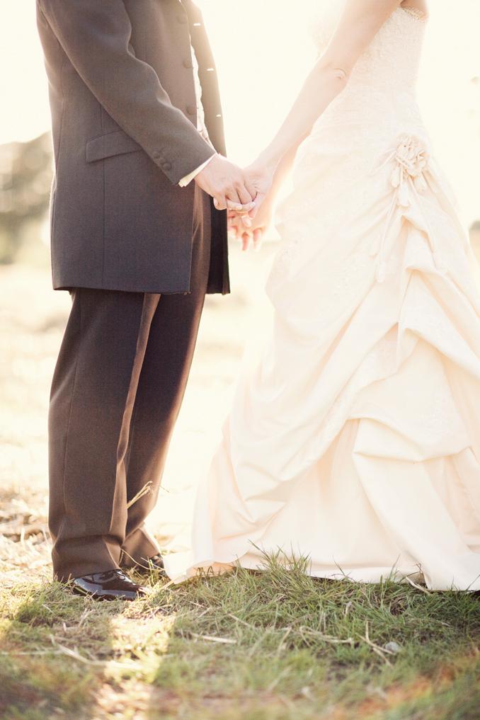 bride and groom holding hands STUDIO 1208