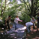 unloading Gabion rock for weed barrier edging