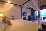 DeluxeWaterVilla_Interior_Bedroom_Side_View.jpg