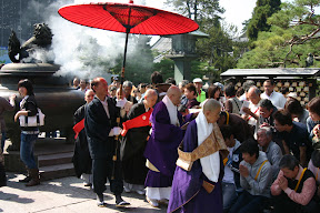 Priests giving a blessing in the courtyard of Zenko-ji Temple