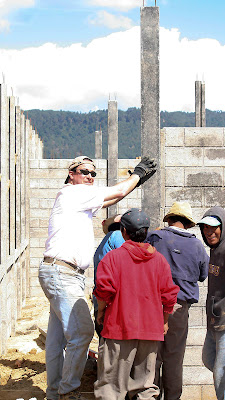 "Jason helping steady a column. Jason is a big guy in the states, but here....One of the villagers called 5'3"" Ira 'muy alto' (very tall). Photos by TOM HART"