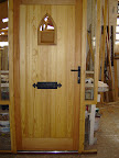 Softwood doorset with glazed winglights and gothic arch glazed apperture