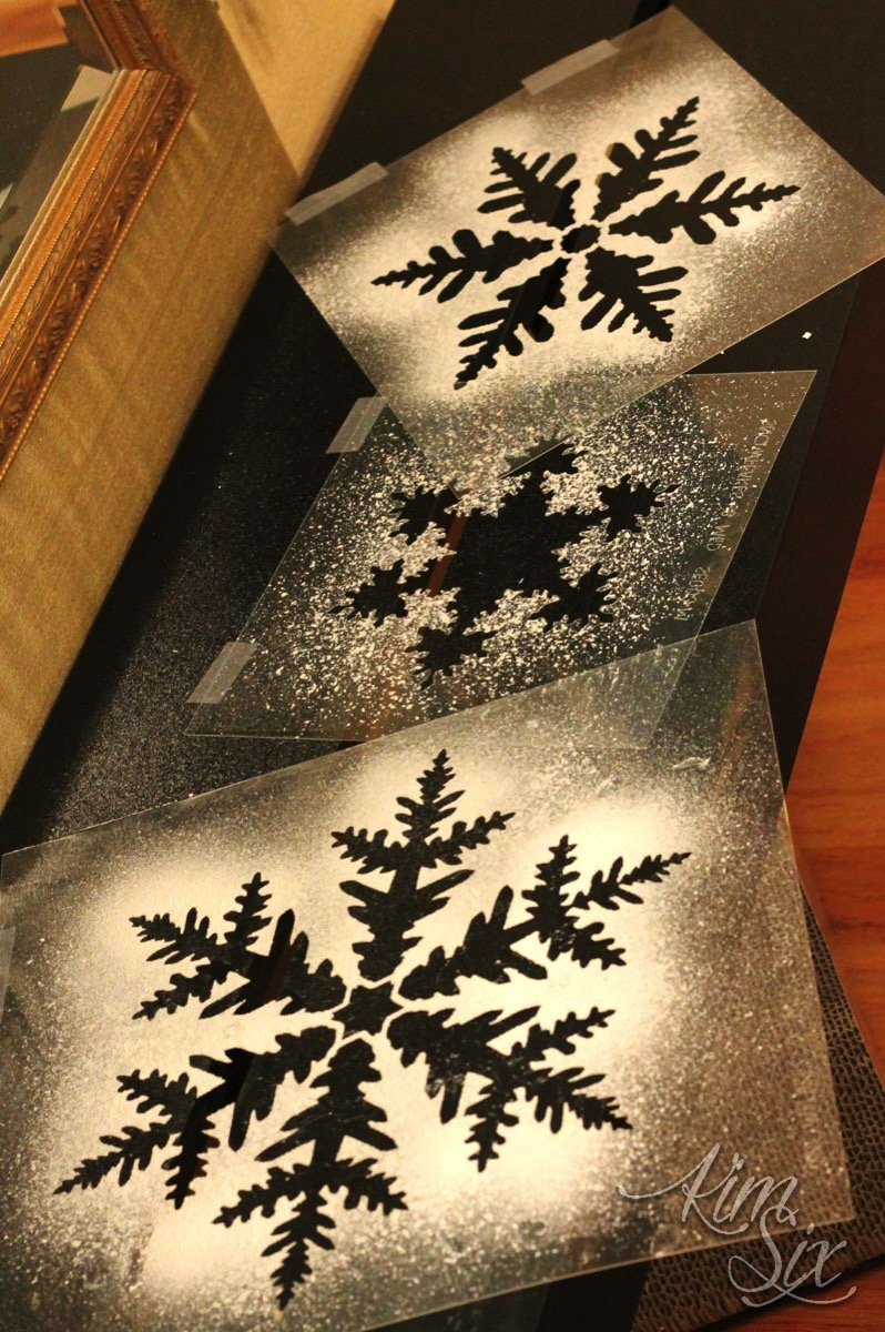Snowflake stencils with spray snow