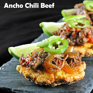 Slow Cooker Ancho Chili Shredded Beef over Corn Fritters.