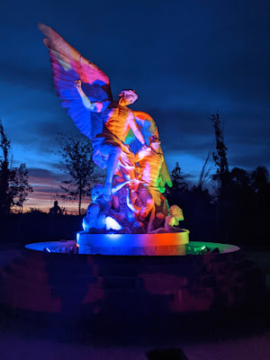 Evermore Statue Lit Up at Night