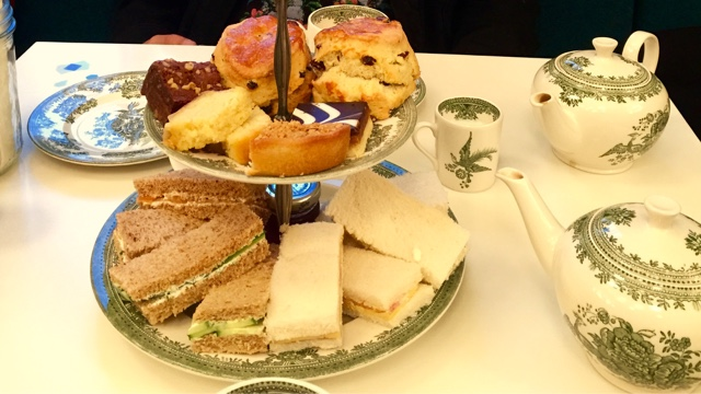 Afternoon tea with sandwiches, scones and cakes at Wellcome Collection London