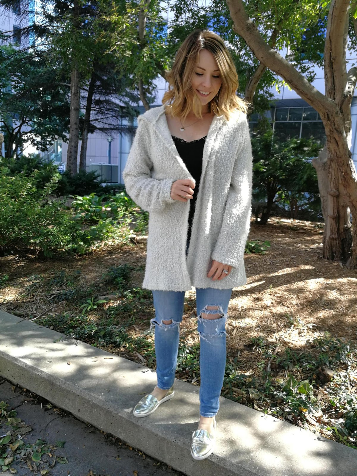 Teddy bear sweater, ripped jeans and gold flats