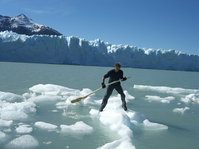 Using an iceberg as a stand up paddle board Perito Moreno Glacier Patagonia