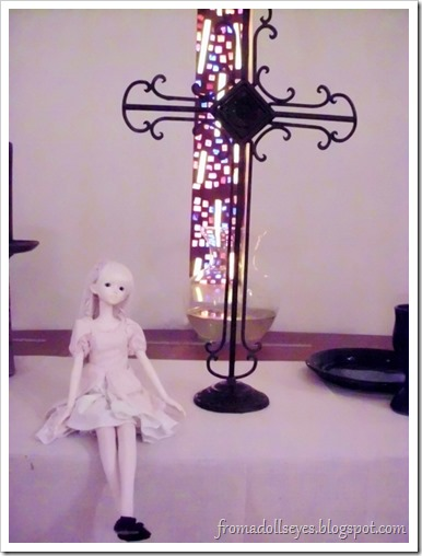 A bjd sitting on an altar