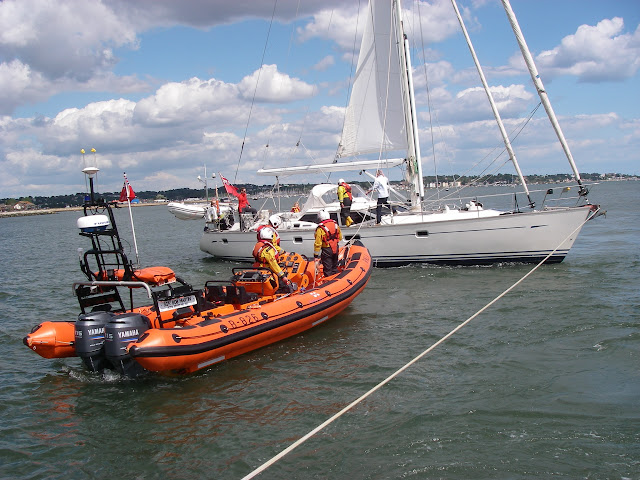 31 May 2011 - Poole ILB  preparing to start to heel over the grounded yacht and the Mersey (out of shot) positioning itself to tow the yacht