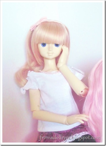 Closeup of the other msd sized ball jointed doll.  She is touching her hand to her face in the cute way she always does.