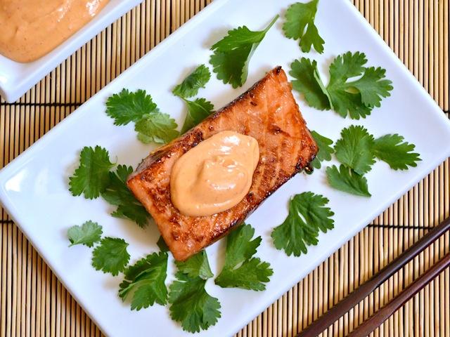 Top view of teriyaki salmon with sriracha mayo on plate