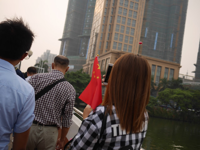 young woman with a PRC flag in Zhongshan, China