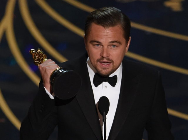 Actor Leonardo DiCaprio accepts the award for best actor in 'The Revenant'. Photo: Mark Ralston / AFP