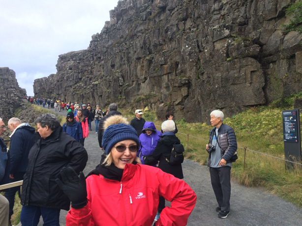 Resident Astronomer Peggy poses at the tectonic plate spreading location in Iceland