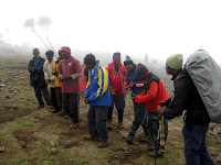 Kili Climb Day 2 - Welcome to camp song by our 12-person team!