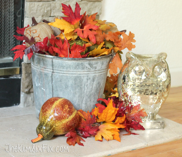 Vintage tin bucket with fall decorations