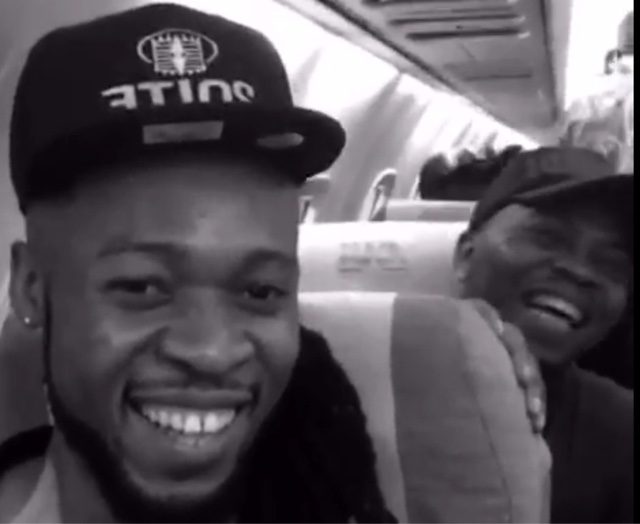 Flavor and olamide shares cool moment in plane