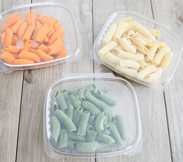 overhead photo of packages of different colored pastas