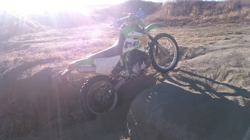 Greg took Chris's 2-stroke out for a test ride. Who needs a sidestand???