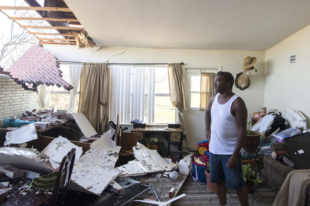 Robert Hill surveys the damage within his living room on Wednesday, 17 October 2018 at Tyndall Air Force Base, after Hurricane Michael hit the base last week. Support personnel from Tyndall and other bases were on location to support Airmen returning to their homes to assess damage and collect personal belongings. Photo: Kelly Walker / U.S. Air Force