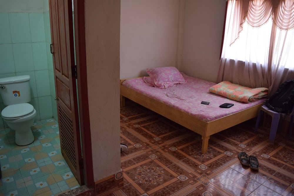 My glorious hotel in Savannakhet, which even included a sit-down toilet, for $6 bucks a night.... no shower, but had a bucket and scooper... just like all my showers in the Philippines!