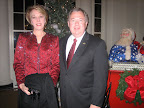 Brenda and Tarrant County Judge Glen Whitley enter the Christmas reception at The White House.