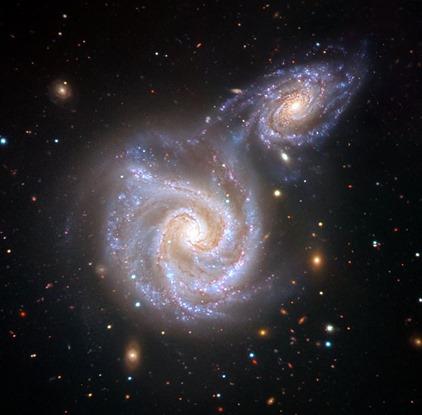 ilustração do encontro entre a Via Láctea e a galáxia da Salsicha
