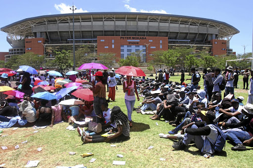 Prospective students wishing to register for courses at Capricorn TVET College in Polokwane in January formed long queues in the Peter Mokaba Stadium to get registered. Picture: ANTONIO MUCHAVE